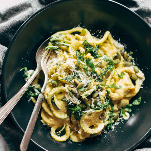 zucchini pasta spirals with creamy corn sauce